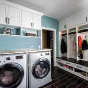 Laundry room with bench